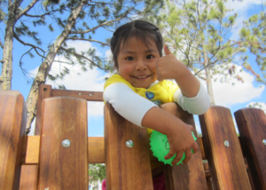 Happy girl receiving assistance from a Hearts of Gold program in Cuenca, Ecuador.