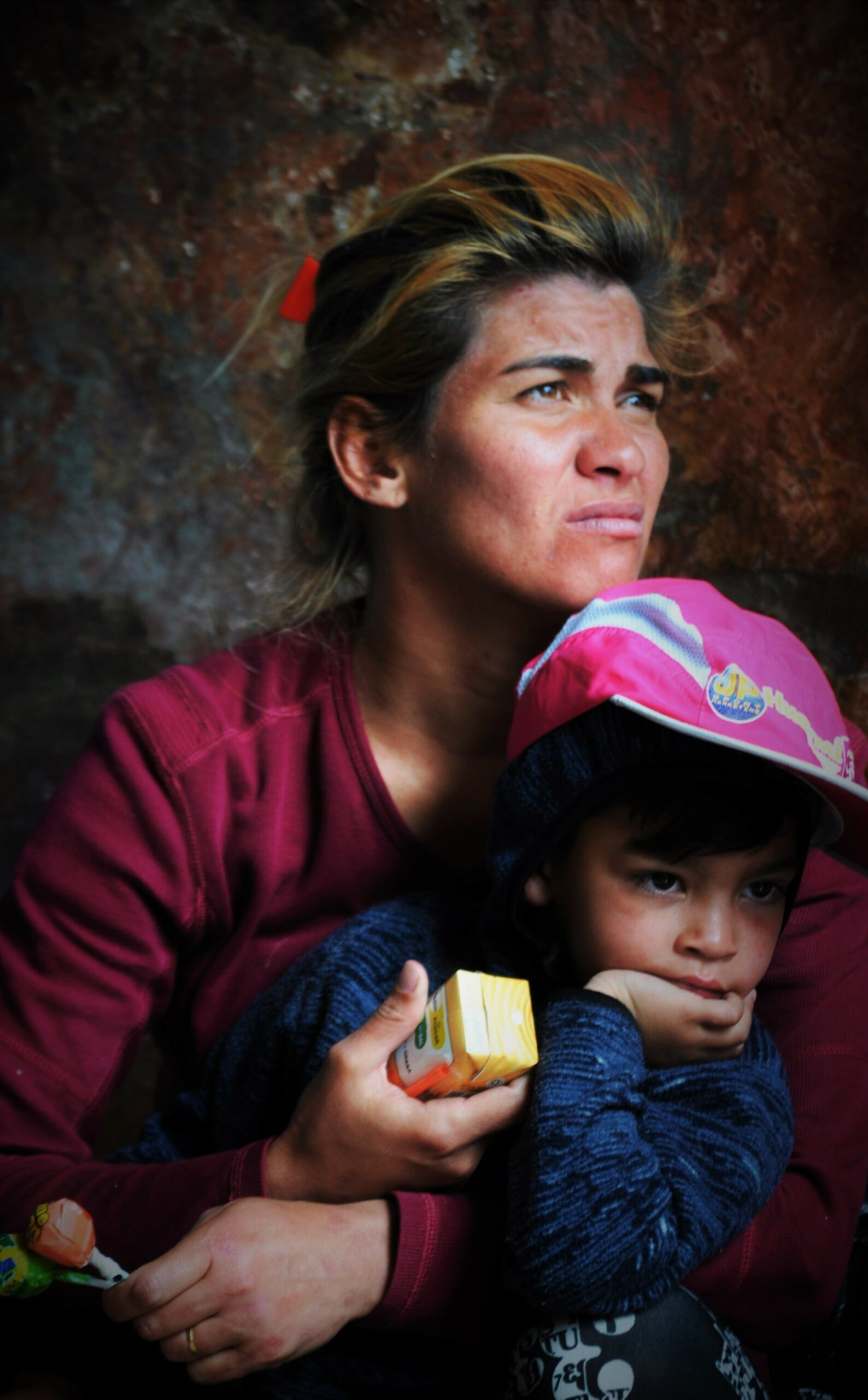 Mother and son receiving food assistance from our daily Food Outreach Program, which is one of several services provided by Snow Angels in Ecuador .